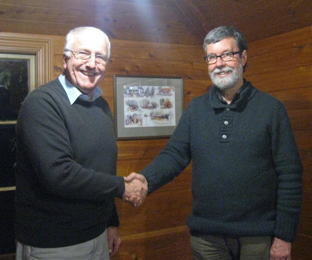 Simon Martin Garry Moore handshake